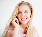 Beautiful smiling female talking on a cell phone