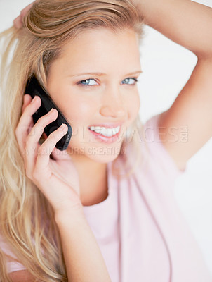 Buy stock photo Closeup of a smiling cute woman talking over the cellphone