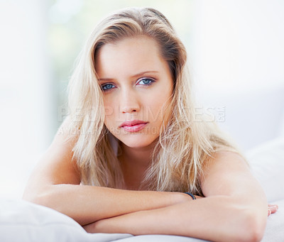 Buy stock photo Portrait of a pretty and relaxed blond female sitting at home