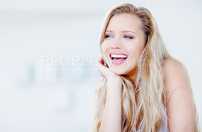 Buy stock photo Portrait of a laughing young blond female looking at copyspace