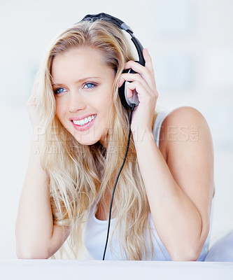 Buy stock photo Portrait of a cute and happy female enjoying music over headphones