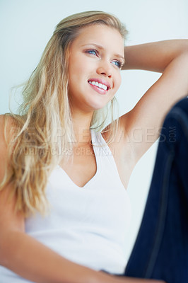 Buy stock photo Portrait of a smiling young blond female looking away