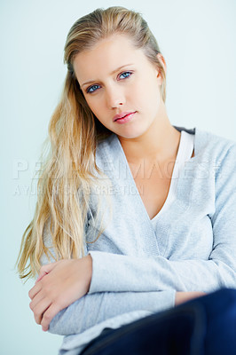 Buy stock photo Cute young Caucasian female sitting against a wall
