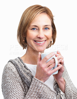 Buy stock photo Portrait of a pretty mature lady enjoying a cup of coffee isolated over a white background