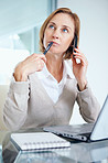 Middle aged businesswoman thinking while calling on mobile