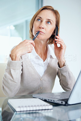 Buy stock photo Portrait of pretty middle aged businesswoman thinking while calling on mobile