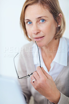 Buy stock photo Portrait of happy business woman holding glasses while working