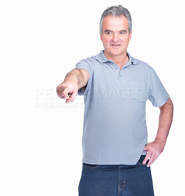 Buy stock photo Happy mature man pointing a finger isolated on white background