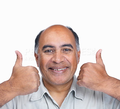 Buy stock photo Closeup portrait of a happy mature man gesturing a thumbs up sign isolated on white