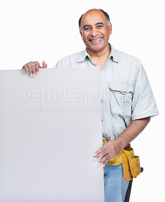 Buy stock photo Portrait of a happy mature carpenter holding a blank advertisement board on white