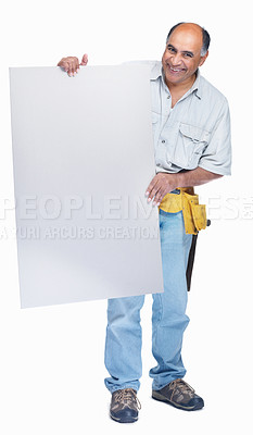 Buy stock photo Full length of a smiling mature handyman advertising your product on an empty billboard