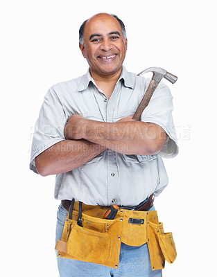 Buy stock photo Portrait of a happy handyman wearing a tool belt with hammer in hand