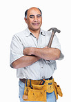 Mature handyman wearing a tool belt with hammer in hand
