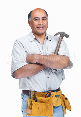 Buy stock photo Confident middle aged handyman wearing a tool belt with hammer in hand