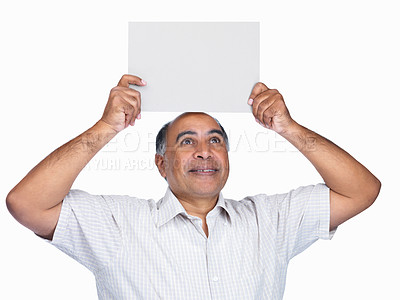 Buy stock photo Portrait of a mature man holding a blank billboard over head against white