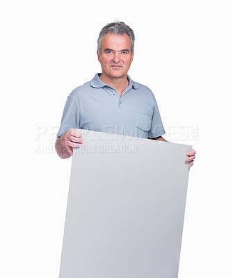 Buy stock photo Portrait of a handsome senior man holding a blank billboard isolated on white
