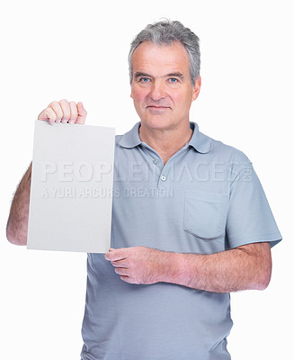 Buy stock photo Portrait of a smiling senior man holding a blank billboard isolated against white