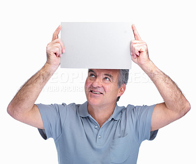 Buy stock photo Smiling elderly man holding a blank billboard over head against white