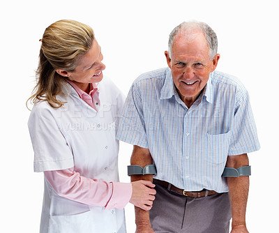 Buy stock photo Portrait of a female nurse helping an old man on crutches against white background