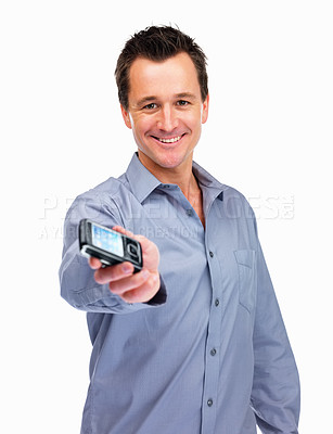Buy stock photo Smart happy mature guy holding a new cell phone isolated on white background