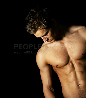 Buy stock photo Studio shot of a brooding bare-chested male model isolated on black