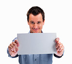 Happy mature man holding blank card against white