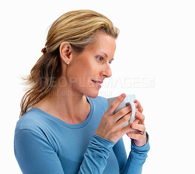 Buy stock photo Cute middle aged woman holding a cup of coffee on white background