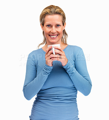 Buy stock photo Confident mature woman holding a cup of coffee on white background