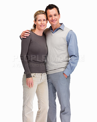 Buy stock photo Portrait of a happy couple standing together against white background