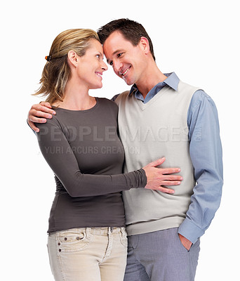 Buy stock photo Happy romantic couple standing together against white background