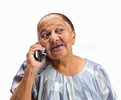 Buy stock photo Closeup portrait of an elderly woman talking on a cellphone against white background