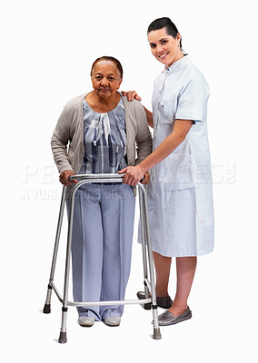 Buy stock photo Full length portrait of a nurse helping an old woman with a walker against white