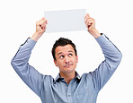 Man holding blank card looking up at sign