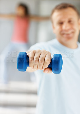 Buy stock photo Man working out at the gym , focus on the blue dumbbell
