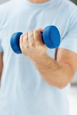 Buy stock photo Closeup of a strong human hand holding a blue dumbbell