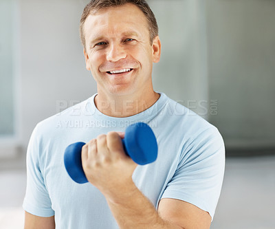 Buy stock photo Portrait of smart middle aged man working out with a dumbbell