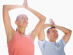 Couple practicing yoga together with hands joined above head