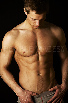 Buy stock photo Studio shot of a handsome bare-chested male model isolated on black