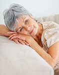 Day dreaming - Closeup of a senior woman relaxing on a couch