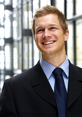 Buy stock photo Confident businessman - A trendy European businessman with a blue tie and shirt. The picture is taken in a city mall.