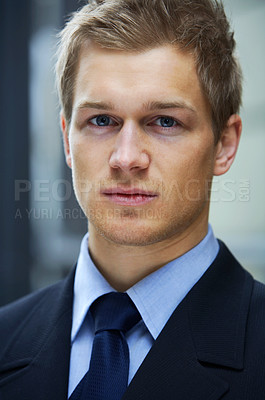 Buy stock photo Confident businessman - A trendy businessman with a blue tie and shirt.