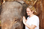 Young researcher with Asian elephant calf - Thailand