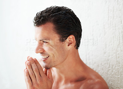 Buy stock photo Sexy handsome man smiling with hands joined
