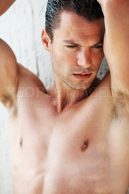 Buy stock photo Portrait of sexy young man thinking while leaning on wall
