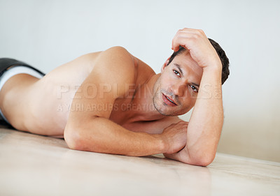 Buy stock photo Portrait of muscular shirtless man lying down on the floor