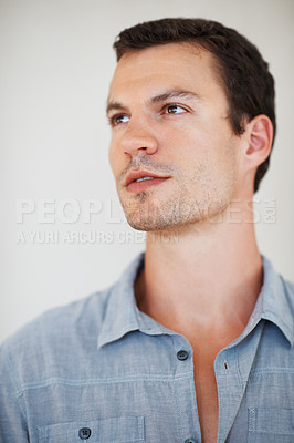 Buy stock photo Closeup of young handsome man looking away