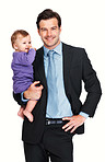 Smiling business man with his baby