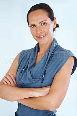 Buy stock photo Portrait of confident mixed race business woman smiling with hands folded
