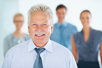 Buy stock photo Portrait of happy senior business man standing with his colleagues