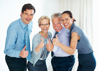 Buy stock photo Portrait of energetic business team giving thumbs up gesture